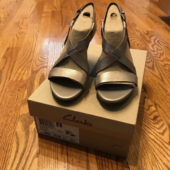 "47439f35b93 Clark s ""Jaelyn Fog"" Gold Leather Dress Sandals"